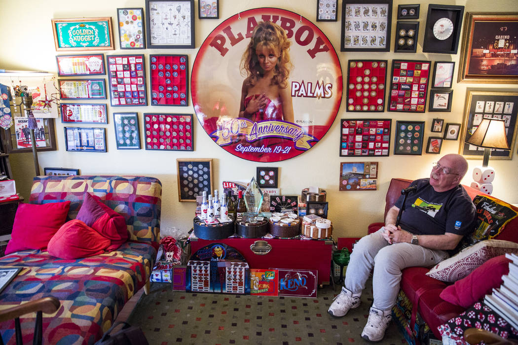 Sheldon Smith sits among his casino collection in his living room. (Todd Prince/Las Vegas Review-Journal)