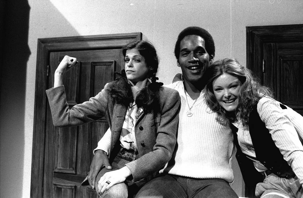 FILE - This Feb. 24,1978 file photo shows O.J. Simpson, center, with actresses Gilda Radner, left, and Jane Curtin as he appeared on NBC's Saturday Night Live in New York. Simpson retired from foo ...