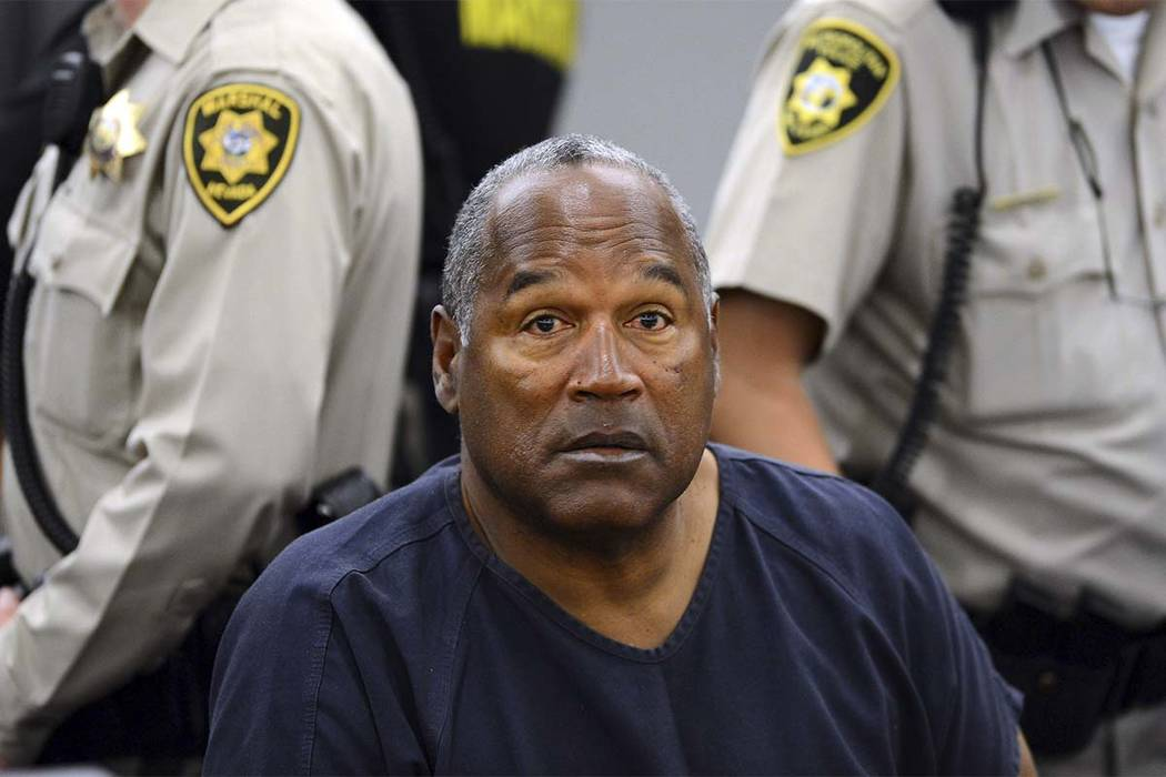 O.J. Simpson sits during a break on the second day of an evidentiary hearing in Clark County District Court in Las Vegas on May 14, 2013. (AP Photo/Ethan Miller, Pool, File)