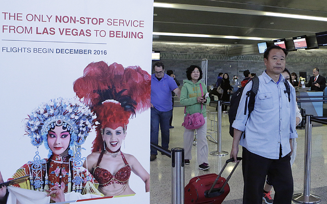 Passengers head to board a Hainan Airlines flight after checking-in at the ticket counter on Monday, Feb. 27, 2017 at McCarran International Airport in Las Vegas. (Bizuayehu Tesfaye/Las Vegas Revi ...