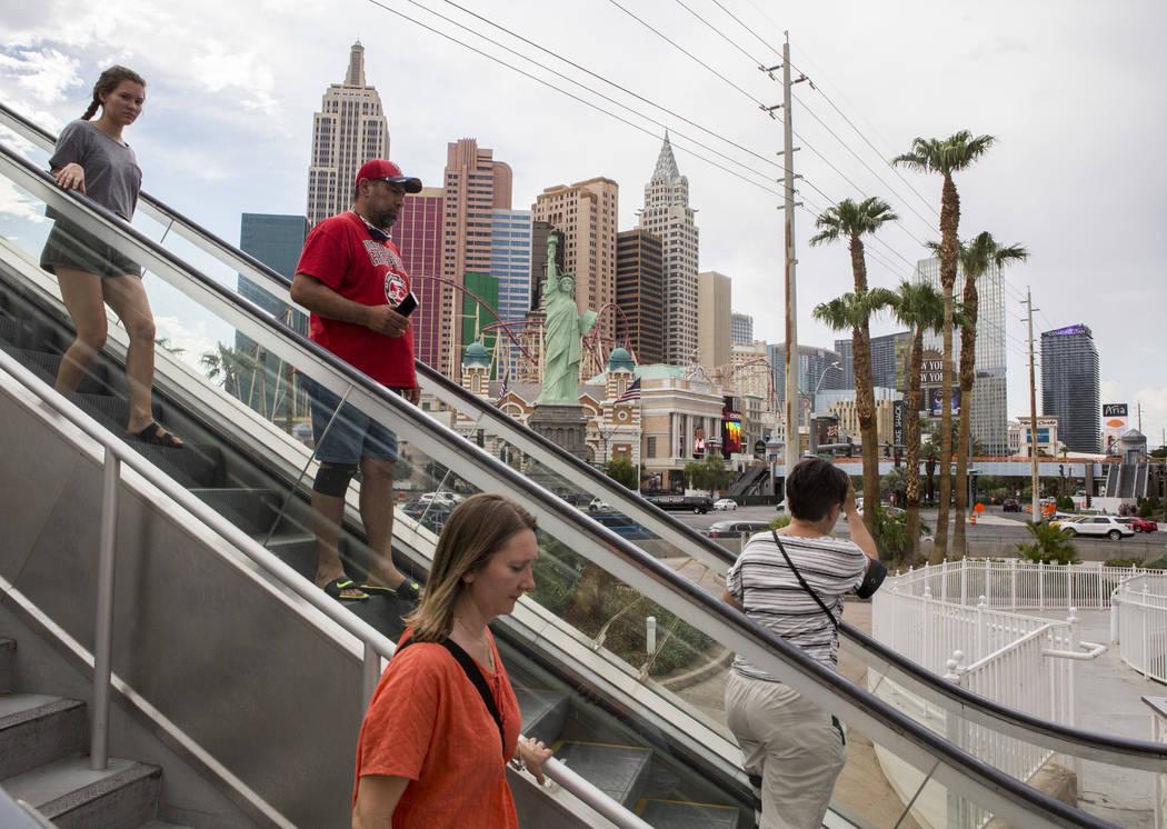 Visitors to the Las Vegas Strip descend on an escalator on Monday, July 17, 2017.  Patrick Connolly Las Vegas Review-Journal @PConnPie