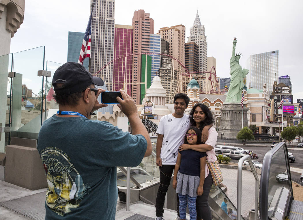 Ashish Mehta takes a photo of his wife Ami and children Arnav, 14, and Veda, 7, on the Las Vegas Strip on Monday, July 17, 2017. The family was visiting from Illinois.  Patrick Connolly Las Vegas  ...