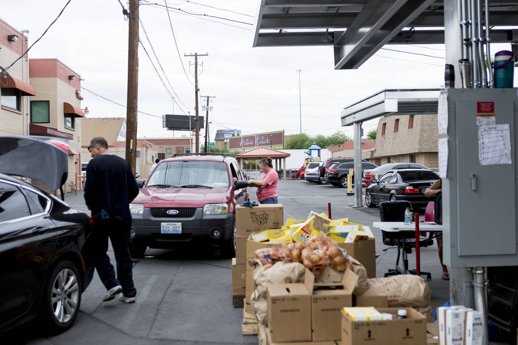 Cars are loaded with food during the United States Department of Agriculture's food commodities distribution giveaway that occurs every other month at the Las Vegas Rescue Mission in Las Vegas, Th ...