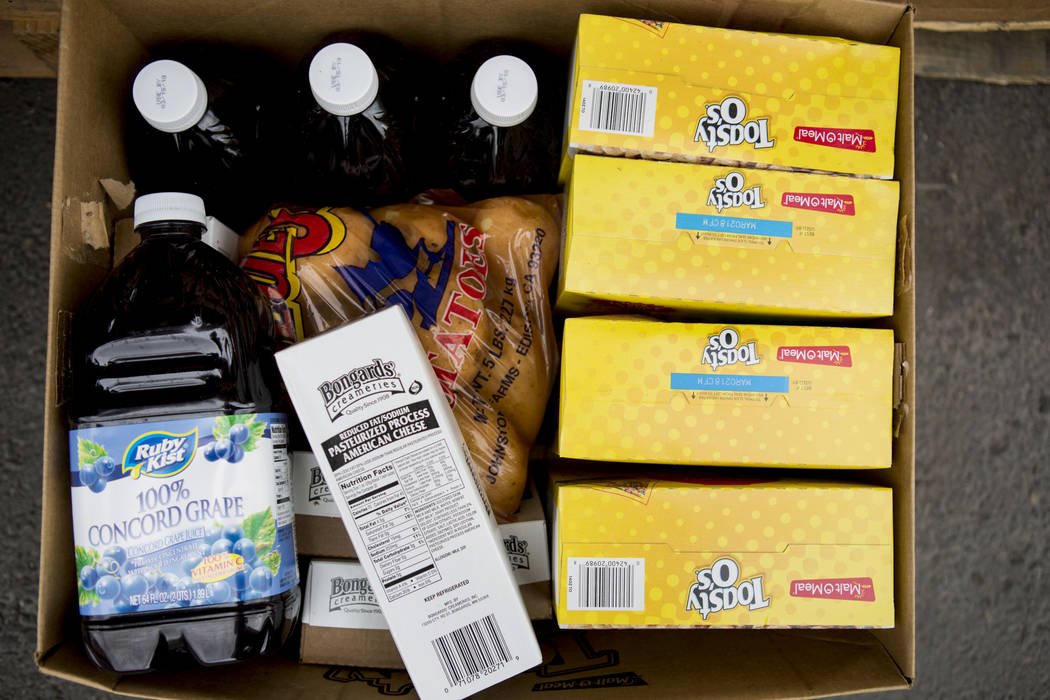 A box of food is ready to load into a family's vehicle during the United States Department of Agriculture's food commodities distribution giveaway that occurs every other month at the Las Vegas Re ...