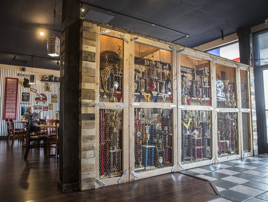 A handmade trophy case filled with BBQ awards greets customers at Sin City Smokers on Wednesday, July 19, 2017, in Henderson. Benjamin Hager Las Vegas Review-Journal @benjaminhphoto