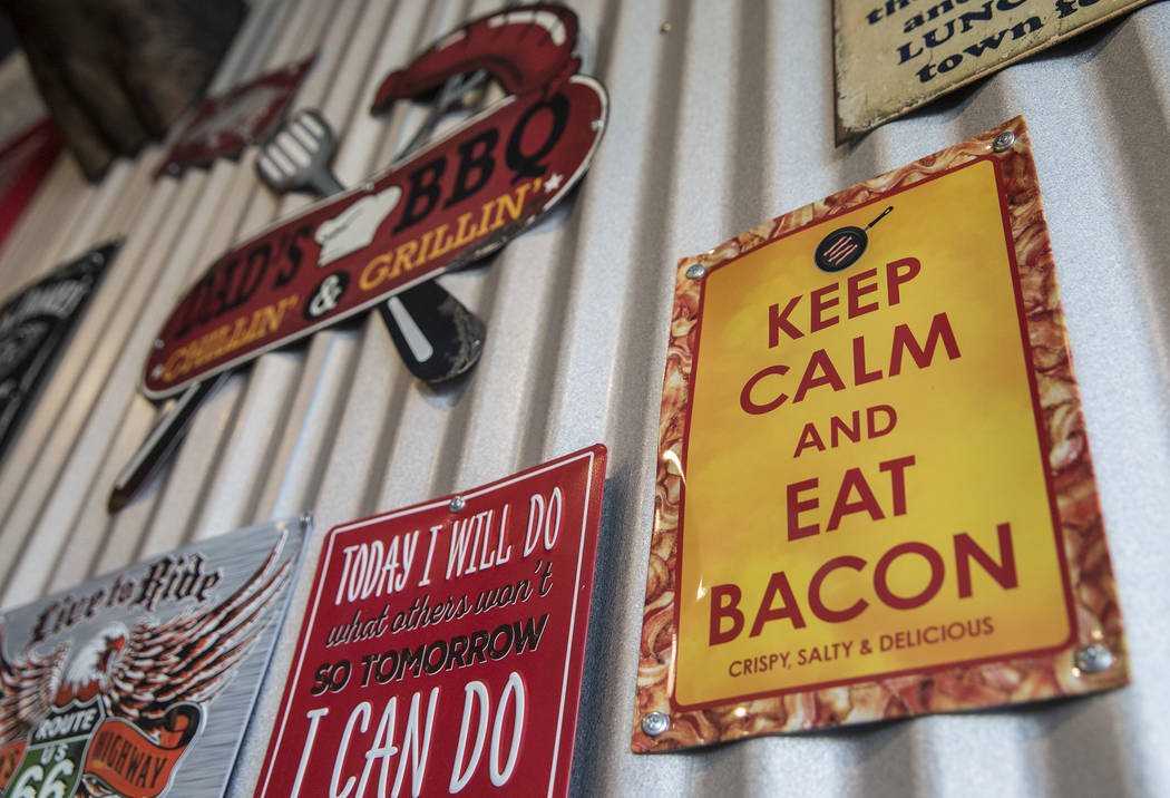Colorful BBQ-themed memorabilia line the walls at Sin City Smokers on Wednesday, July 19, 2017, in Henderson. Benjamin Hager Las Vegas Review-Journal @benjaminhphoto