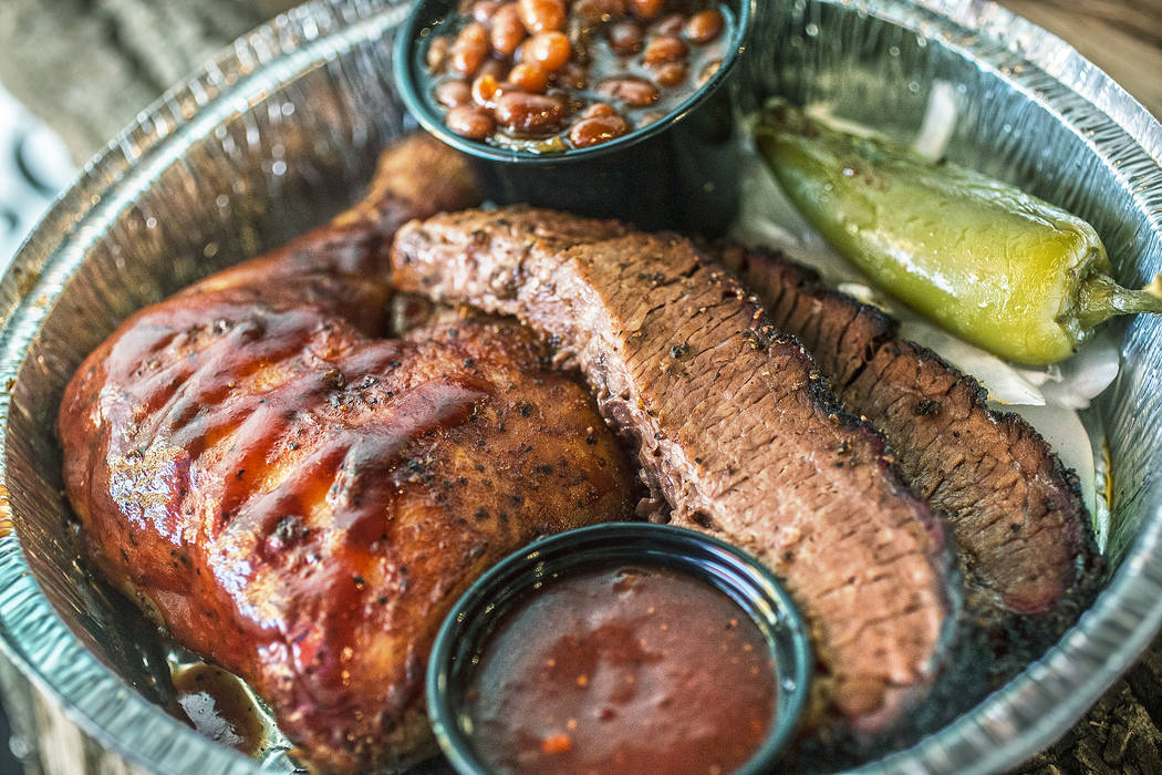 The two meat plate with brisket, chicken and baked beans at Sin City Smokers on Wednesday, July 19, 2017, in Henderson. Benjamin Hager Las Vegas Review-Journal @benjaminhphoto