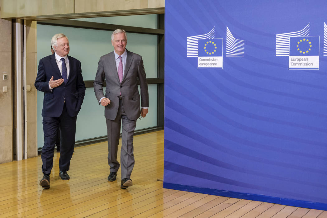 EU chief Brexit negotiator Michel Barnier, right, walks with British Secretary of State David Davis for a meeting at the EU headquarters in Brussels, Monday July 17, 2017. (Geert Vanden Wijngaert/AP)