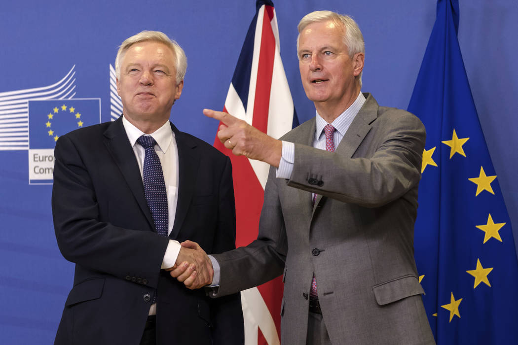 EU chief Brexit negotiator Michel Barnier, right, welcomes British Secretary of State David Davis for a meeting at the EU headquarters in Brussels, Monday July 17, 2017. (Geert Vanden Wijngaert/AP)