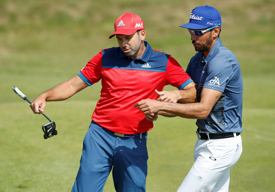 Golf - The 146th Open Championship - Royal Birkdale - Southport, Britain - July 18, 2017   Spain's Sergio Garcia reacts during a practice round as Rafael Cabrera-Bello looks on TPX IMAGES O ...
