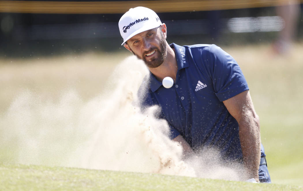 Dustin Johnson of the U.S. plays from the bunker on the 4th hole during a practice round ahead of the British Open Golf Championship, at Royal Birkdale, Southport, England, Monday, July 17, 2017.  ...