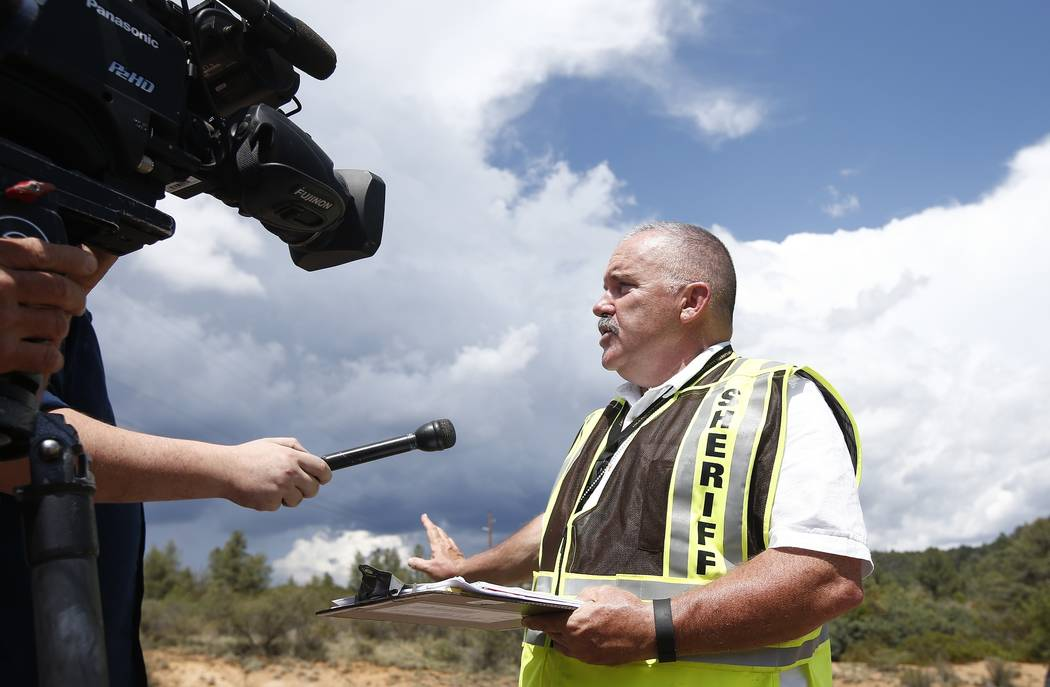 Gila County Sheriff's Office Detective David Hornung updates the media at the First Crossing recreation area during the ongoing search and rescue operation for a victim in a flash flood along the  ...