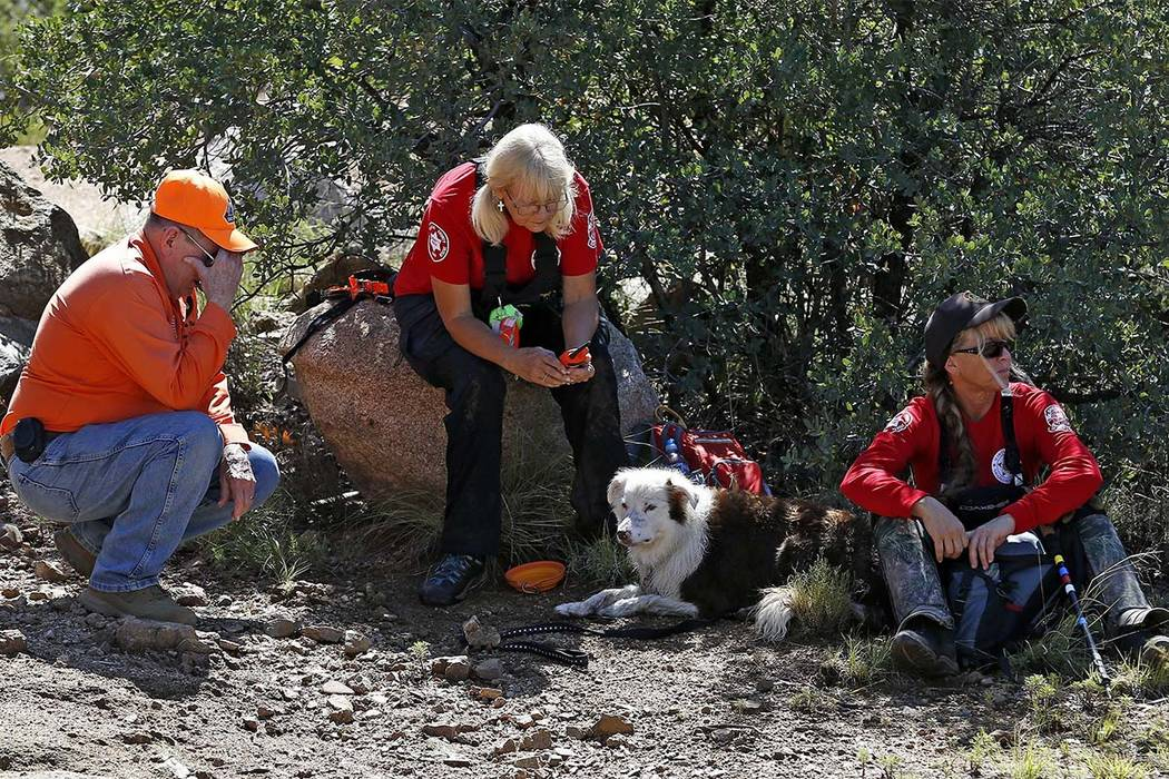 Members of the Navajo County Search and Rescue Team take a break from searching near the entrance to the First Crossing recreation area on Monday, July 17, 2017, in Payson, Arizona.  (Ross D. Fran ...
