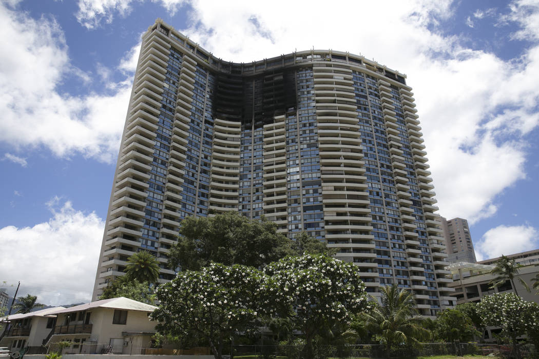 This photo shows the Marco Polo building after a fire gutted several of the top floors of the residential complex, Saturday, July 15, 2017, in Honolulu. A fire broke out Friday afternoon in a unit ...