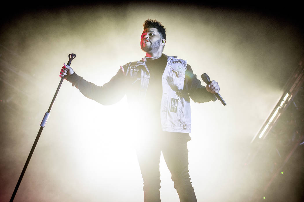 The Weeknd performs at the Bonnaroo Music and Arts Festival on Sunday, June 11, 2017, in Manchester, Tenn. (Photo by Amy Harris/Invision/AP)