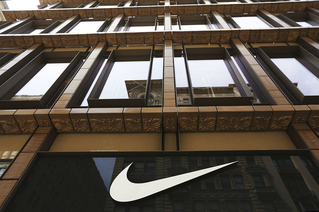 In this Thursday, June 15, 2017, file photo, the Nike logo adorns the Nike SoHo store, in the SoHo neighborhood of New York. Nike, Inc. reports earnings, Thursday, June 29, 2017. (AP Photo/Michael ...