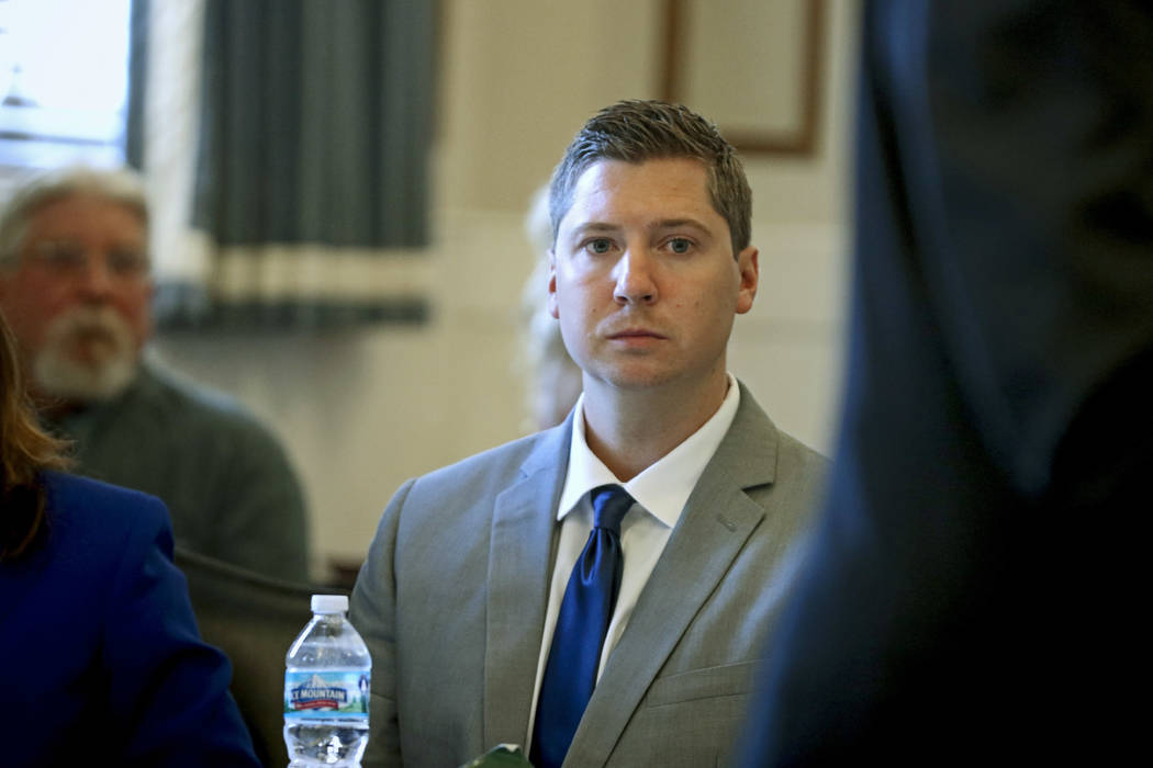 Ray Tensing, center, listens to the opening statement by his defense attorney Stewart Mathews during his retrial Thursday, June 8, 2017, at the Hamilton County Courthouse in Cincinnati. (Cara Owsl ...