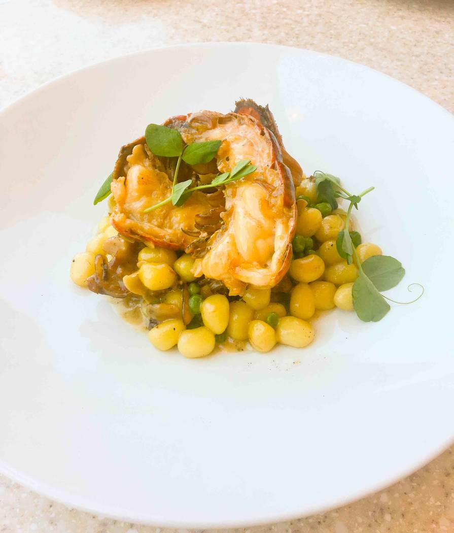 Hexx Kitchen & Bar executive chef  Carlos Buscaglia has added some Italian dishes to the menu, such as this gnocchi made with lobster and smoked pork belly, topped with fresh peas and herbs. ( ...