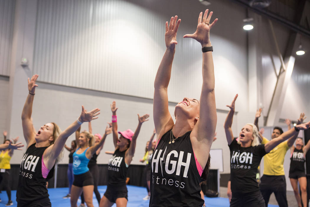 Cate Christinson, right, participates in a High Fitness group aerobics class during the IDEA World Fitness & Nutrition Expo at the Las Vegas Convention Center in Las Vegas on Thursday, July 20 ...
