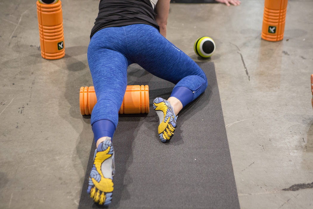 Participants try out a trigger point roller during the IDEA World Fitness & Nutrition Expo at the Las Vegas Convention Center in Las Vegas on Thursday, July 20, 2017. (Bridget Bennett/Las Vega ...