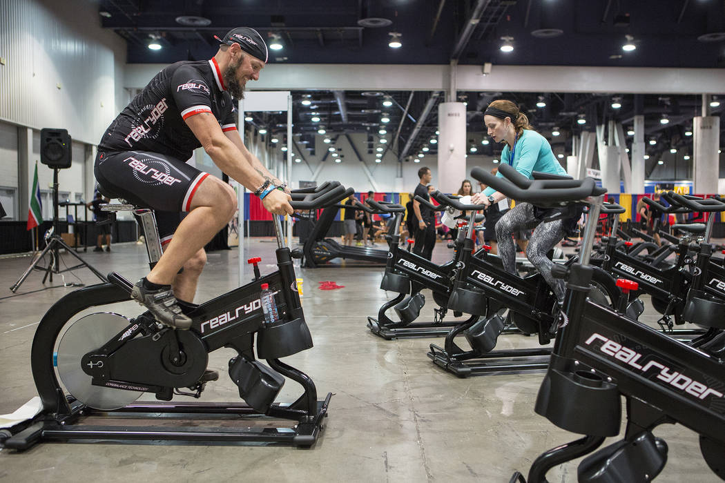 Real Ryder trainer Casey Stutzman, left, leads a brief cycle class during the IDEA World Fitness & Nutrition Expo at the Las Vegas Convention Center in Las Vegas on Thursday, July 20, 2017.  B ...