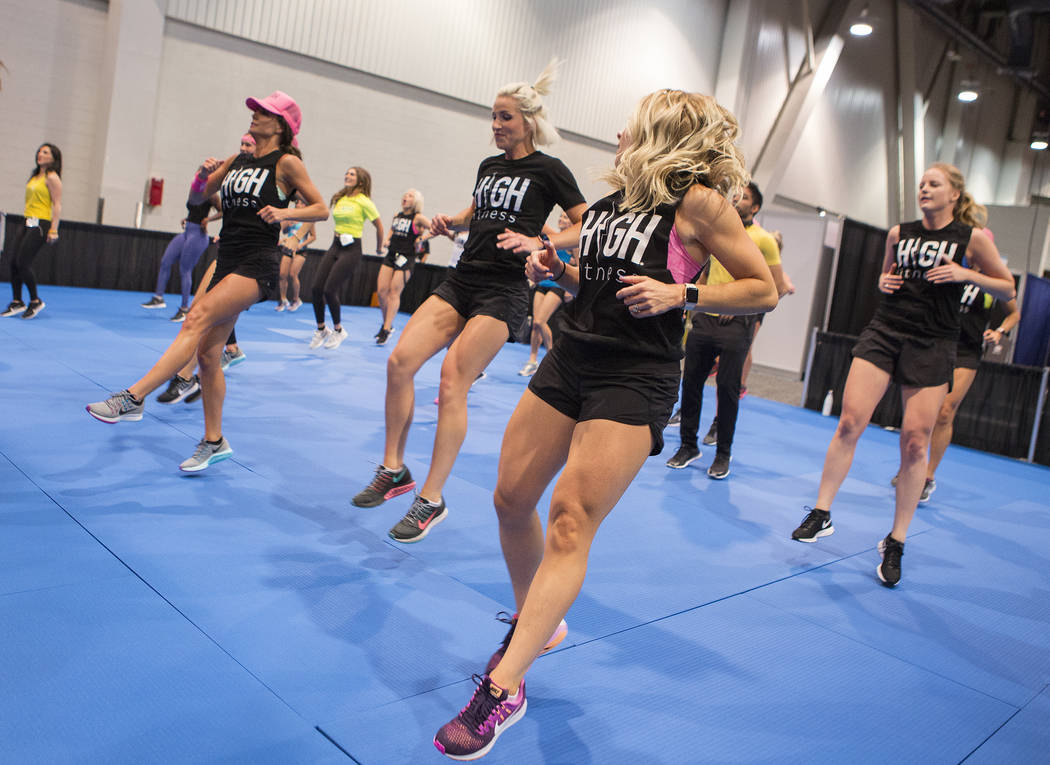 Hailey Seim, right, participates in a High Fitness group aerobics class during the IDEA World Fitness & Nutrition Expo at the Las Vegas Convention Center in Las Vegas on Thursday, July 20, 201 ...