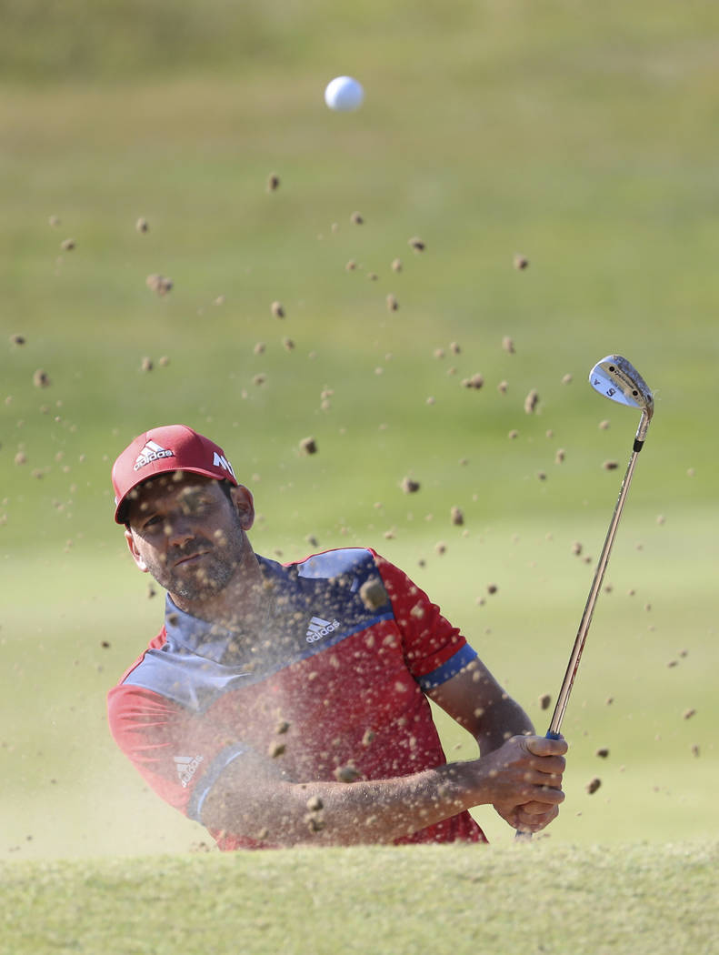 Spain's Sergio Garcia hits a shot from a bunker on the 4th green during a practice round ahead of the British Open Golf Championship, at Royal Birkdale, Southport, England Tuesday, July 18, 2017.  ...