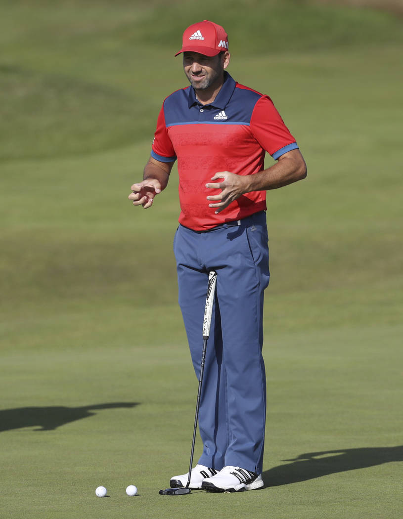 Spain's Sergio Garcia stretches his fingers and hands prior to putting on the 4th green during a practice round ahead of the British Open Golf Championship, at Royal Birkdale, Southport, England T ...