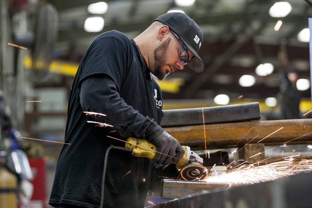Steve Schwinkendorf, a sheet metal apprentice, works on grinding pieces of metal at Young Electric Sign Company,YESCO, in southwest Las Vegas on Wednesday, July 19, 2017.  Patrick Connolly Las Veg ...