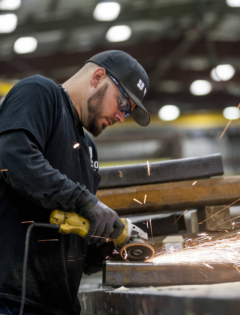 Steve Schwinkendorf, a sheet metal apprentice, works on grinding pieces of metal at Young Electric Sign Company, YESCO, in southwest Las Vegas on Wednesday, July 19, 2017.  Patrick Connolly Las Ve ...