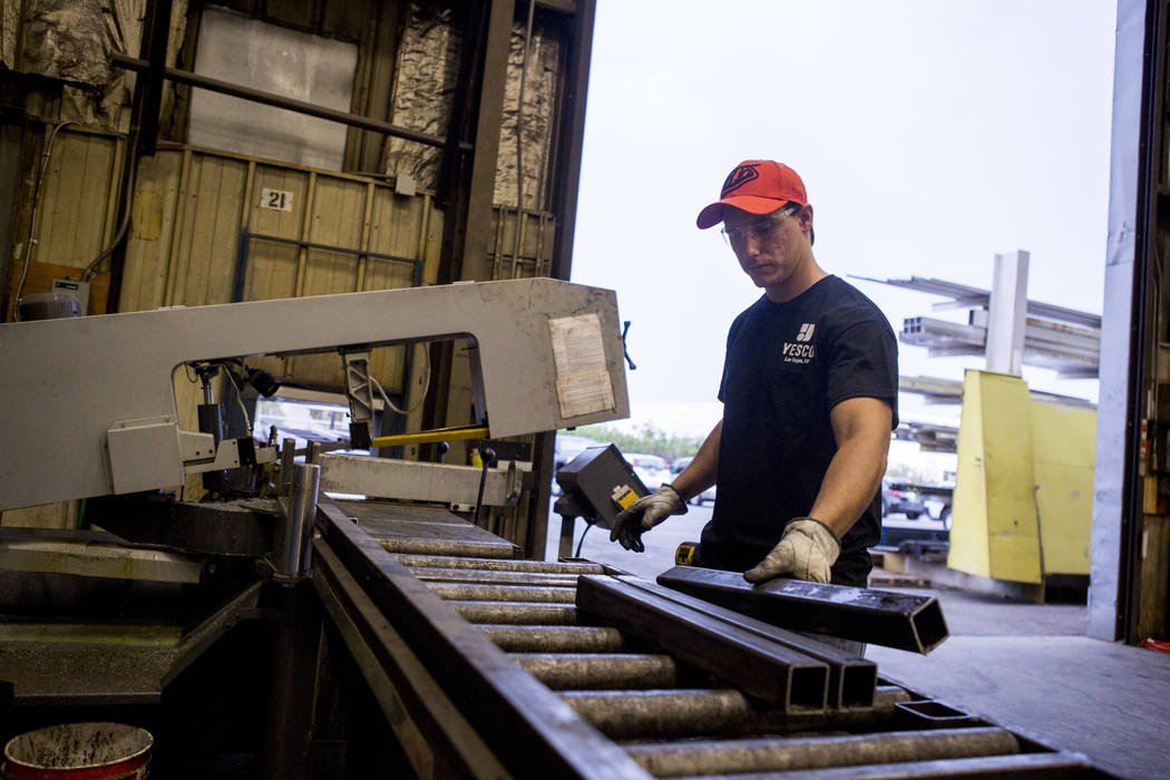 Frank Randell, a sheet metal apprentice, cuts pieces of metal at Young Electric Sign Company,YESCO, in southwest Las Vegas on Wednesday, July 19, 2017.  Patrick Connolly Las Vegas Review-Journal @ ...