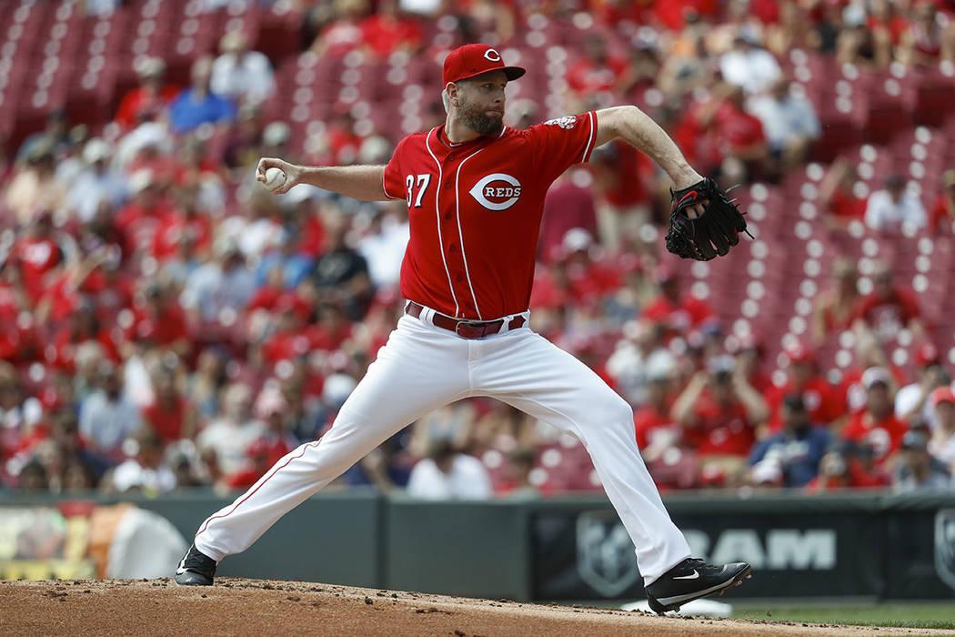 John Minchillo/The Associated Press Cincinnati Reds starting pitcher Scott Feldman throws against the Washington Nationals, in Cincinnati.