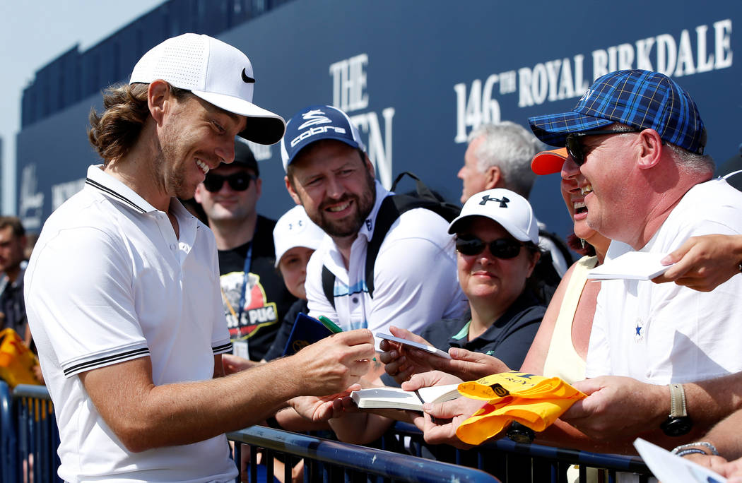 Golf - The 146th Open Championship - Royal Birkdale - Southport, Britain - July 18, 2017   England's Tommy Fleetwood signs autographs for fans during a practice round   REUTERS/Paul Childs