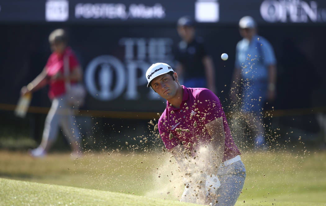 Spain's Jon Rahm plays out of a bunker on the 4th green during a practice round ahead of the British Open Golf Championship, at Royal Birkdale, Southport, England Tuesday, July 18, 2017. (AP Photo ...