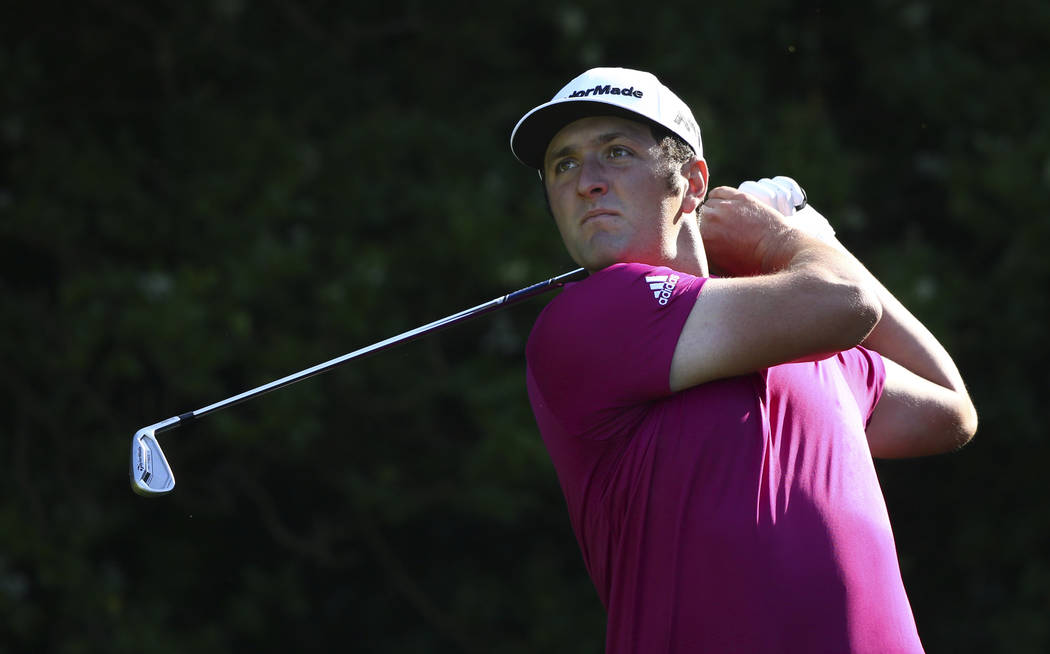 Spain's Jon Rahm hist his tee shot at the 5th during a practice round ahead of the British Open Golf Championship, at Royal Birkdale, Southport, England Tuesday, July 18, 2017. (AP Photo/Dave Thom ...