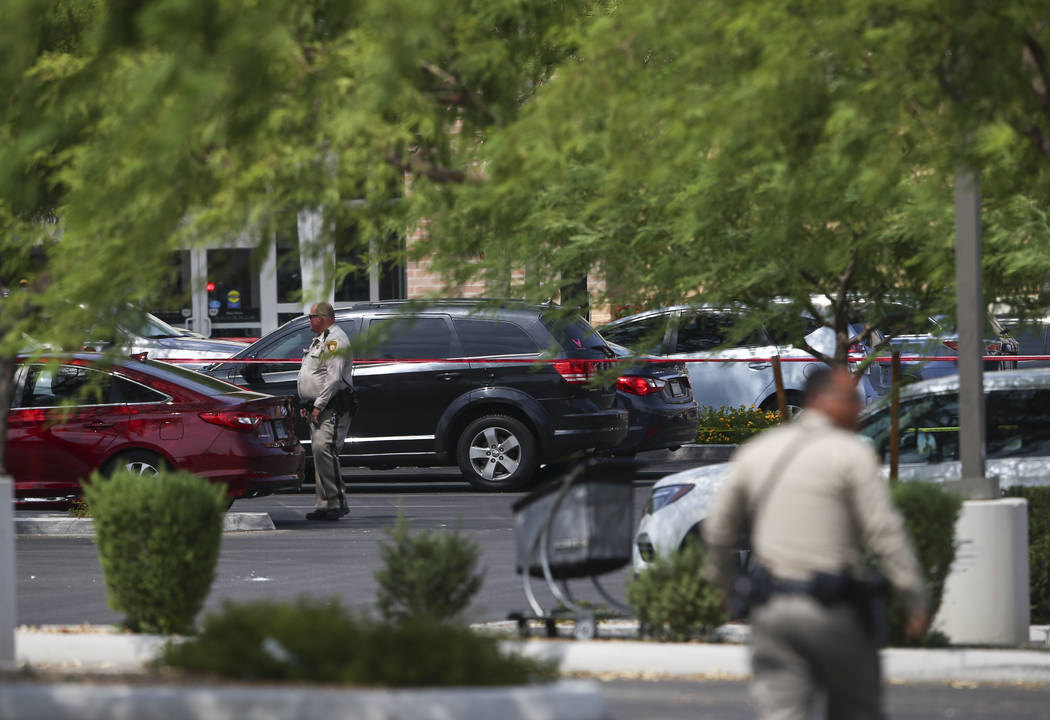Las Vegas police investigate the scene of an officer-involved shooting in a shopping center at the 6700 block of North Durango Drive in Las Vegas on Tuesday, July 18, 2017. Chase Stevens Las Vegas ...