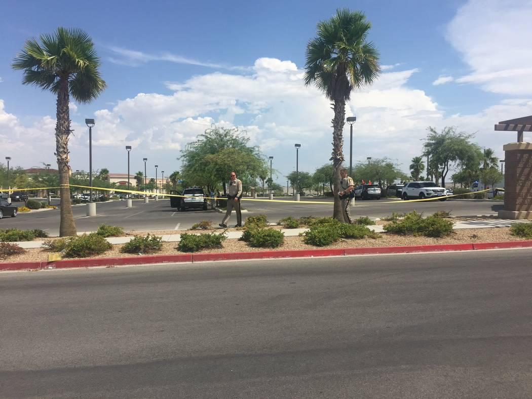 Las Vegas police investigate the scene of an officer-involved shooting in a shopping center at the 6700 block of North Durango Drive in Las Vegas on Tuesday, July 18, 2017. (Marian Green/Las Vegas ...