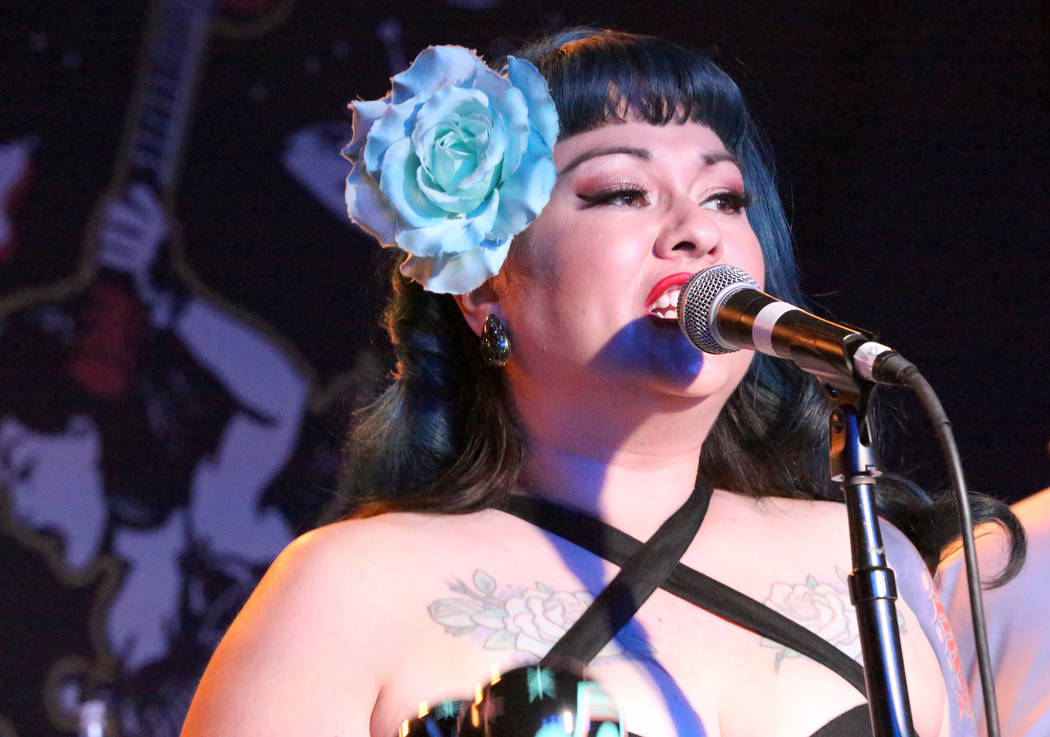 Shanda Cisneros, of local Las Vegas band Shanda and the Howlers, sings one of the band's originals after hours at the Bailiwick Pub during the Viva Las Vegas Rockabilly Weekender at the Orleans  ...
