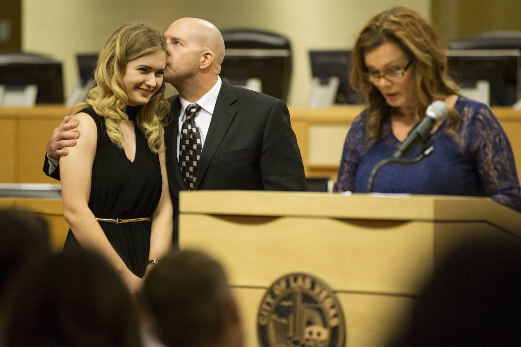 Graduate Sarah Hawk, left, is kissed by her father Mike as her mother Chris gives a speech during the Youth Offender Court graduation at Las Vegas City Hall in Las Vegas, on Thursday, July 20, 201 ...