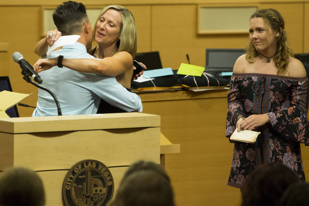 Graduate Corey McArdle, from left, hugs his mother Denise Wheeler as his sister Dylan looks on during the Youth Offender Court graduation at Las Vegas City Hall in Las Vegas, on Thursday, July 20, ...