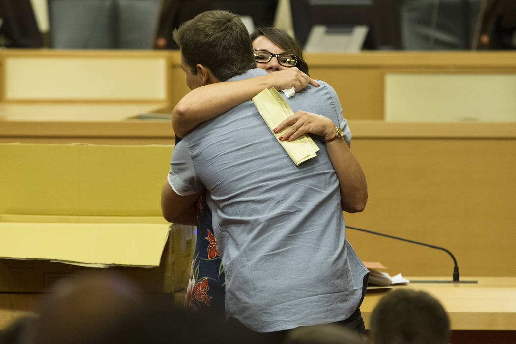 Graduate Cody Hoover, front, hugs his mother Lisa, after his speech during the Youth Offender Court graduation at Las Vegas City Hall in Las Vegas, on Thursday, July 20, 2017. Erik Verduzco Las Ve ...