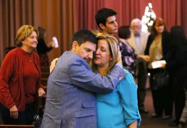 Tina Lavoie gets a hug from state Sen. Mark Manendo, D-Nev, during an event marking the World Day of Remembrance at Palm Mortuary on Sunday, Nov. 20, 2016, in Las Vegas. The event was held to reme ...