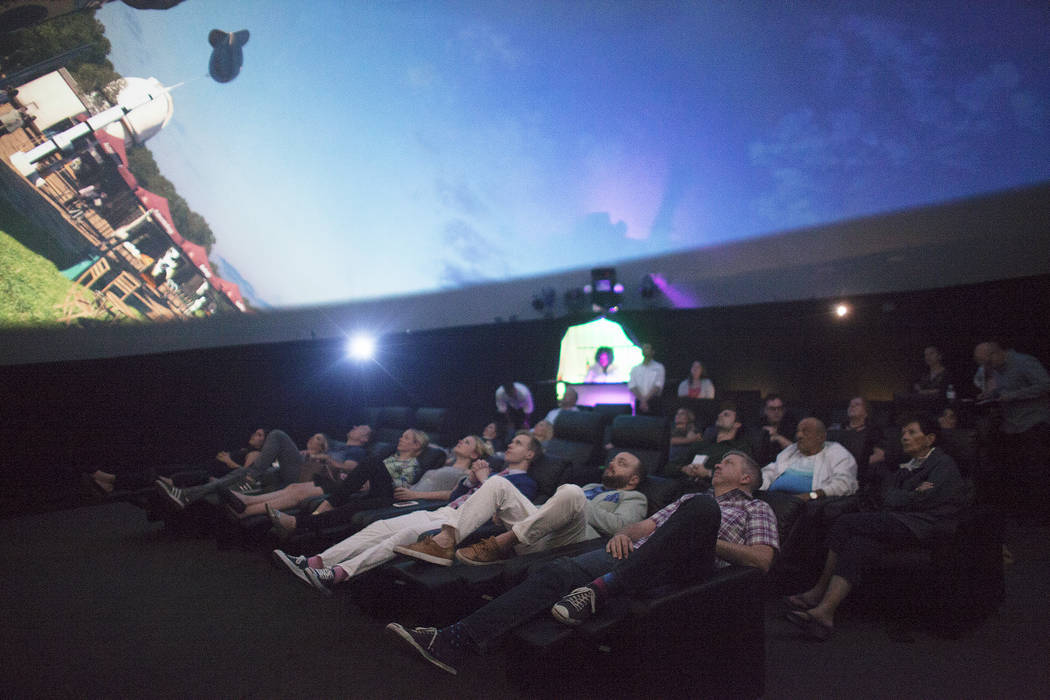 An audience watches a preview of a movie inside The Dome, a 360 theatre that will be showing six different films to the public, on Thursday, April 27, 2017, at the Container Park in Downtown Las V ...