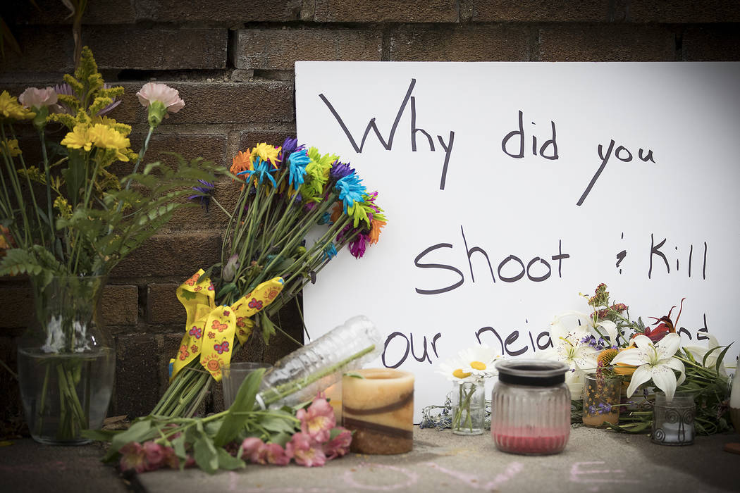 A makeshift memorial is left at the scene where a Minneapolis police officer shot and killed Justine Damond, Monday, July 17, 2017 in Minneapolis.  (Elizabeth Flores/Star Tribune via AP)