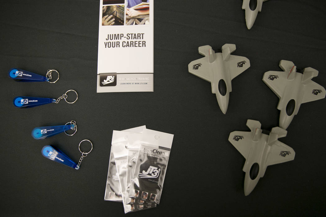 Pamplets and F-35 aircraft stress relief toys on JT3's recruitment table during a Veteran and Family Career Fair at UNLV in Las Vegas, Saturday, July 22, 2017.  Gabriella Angotti-Jones Las Vegas R ...