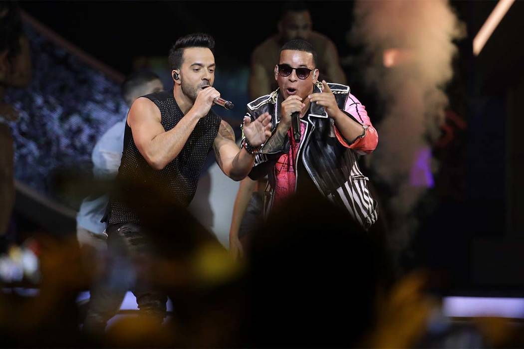 In this April 27, 2017 file photo, singers Luis Fonsi, left and Daddy Yankee perform during the Latin Billboard Awards. Universal Music Latin Entertainment announced Wednesday, July 19, 2017, that ...