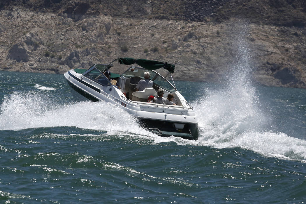 Vacationers ride a boat at Lake Mead Recreational Area, on Friday, May 26, 2017. Bizuayehu Tesfaye Las Vegas Review-Journal @bizutesfaye