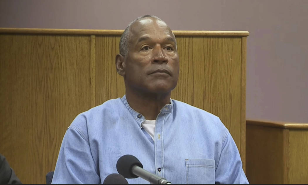 Former NFL football star O.J. Simpson appears via video for his parole hearing at the Lovelock Correctional Center in Lovelock, Nev., on Thursday, July 20, 2017.  Simpson was convicted in 2008 of  ...