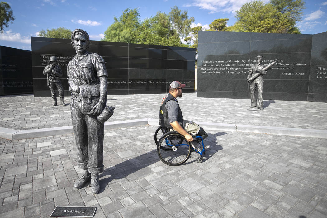 Retired Marine Cpl. Neil Frustaglio browses around at the Veterans Memorial outside the Sawyer Building, Saturday, July 29, 2017, after an overnight stop during the 3rd annual Veterans Charity Rid ...