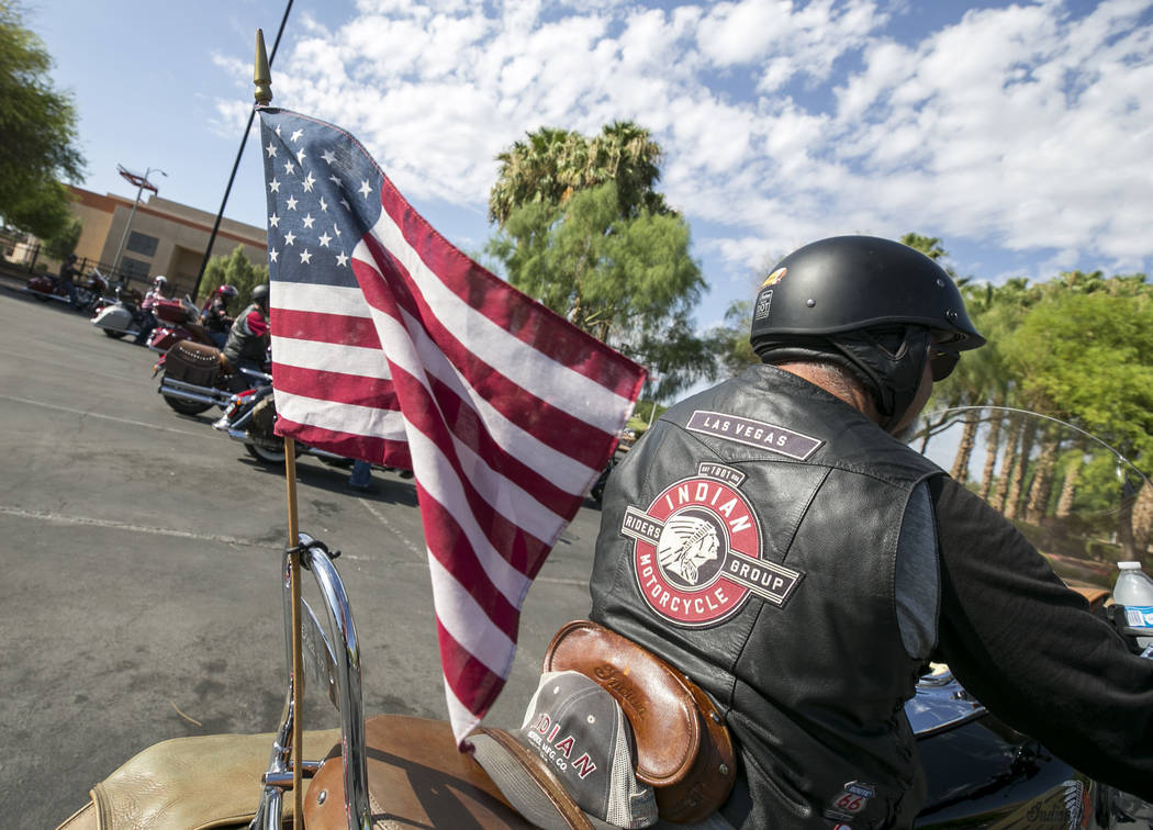 A rider departs the Veterans Memorial outside the Sawyer Building, Saturday, July 29, 2017, after an overnight stop during the 3rd annual Veterans Charity Ride from Los Angeles to the Sturgis Moto ...